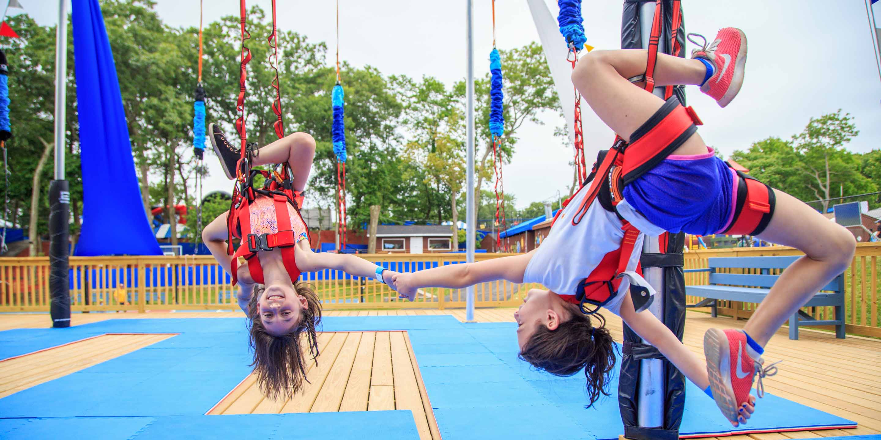 Girls on swings upside down