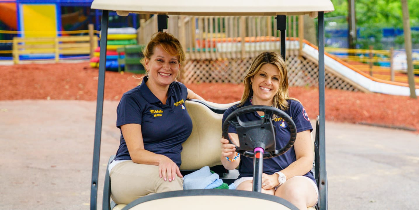 Staff on golf cart